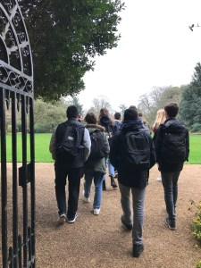 A group of students touring the Great Lawn on a school visit to St John's College