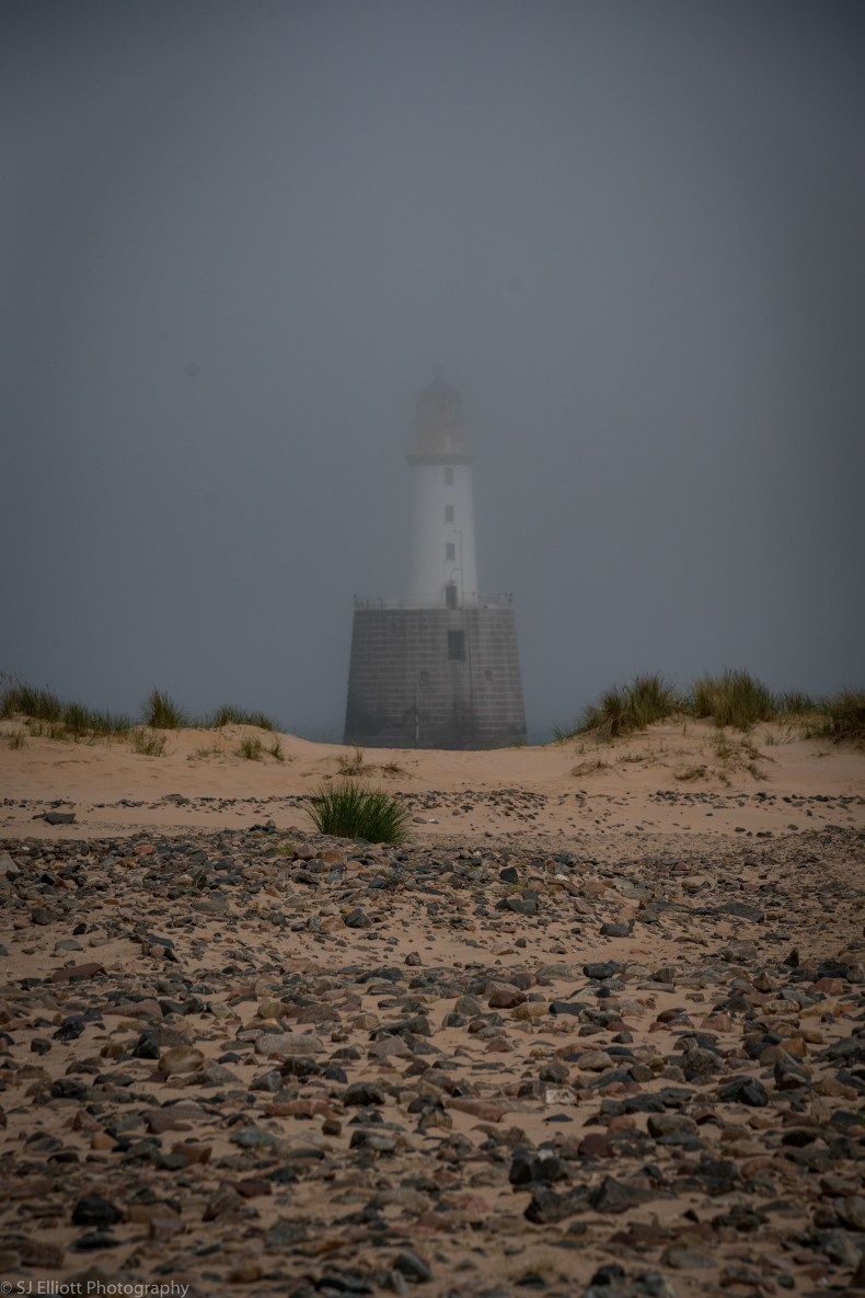 The fog beginning to fully envelop the lighthouse