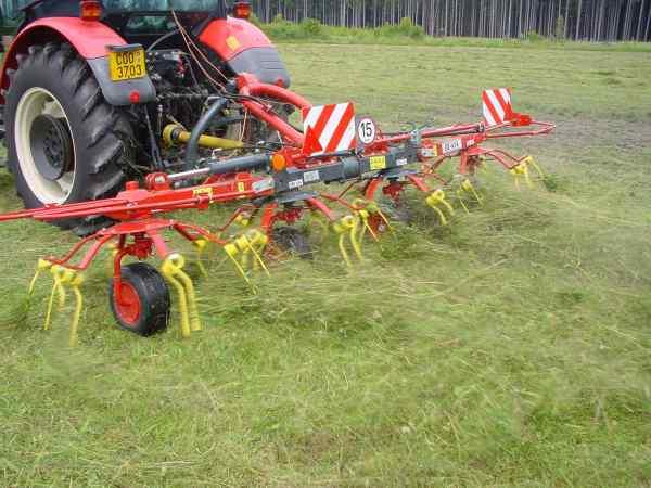 Rozmital OZ454 Hay Tedder tedding freshly cut grass.
