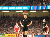 Dan Carter looks on.