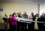 Kedzie Center Executive Director Angela Sedeno cuts the ribbon at the center's grand opening on Oct. 29, 2014. (CCSOMHC)