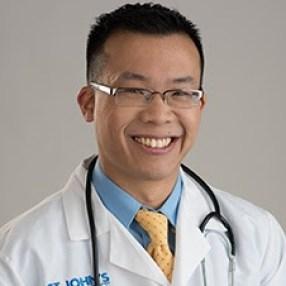 portrait of Doctor Norman Mok