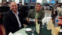 Dr. Saleem presents Dr Nowshad Khan with a pen