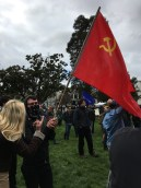 An anonymous anti-Trump demonstrator sporting a USSR flag.