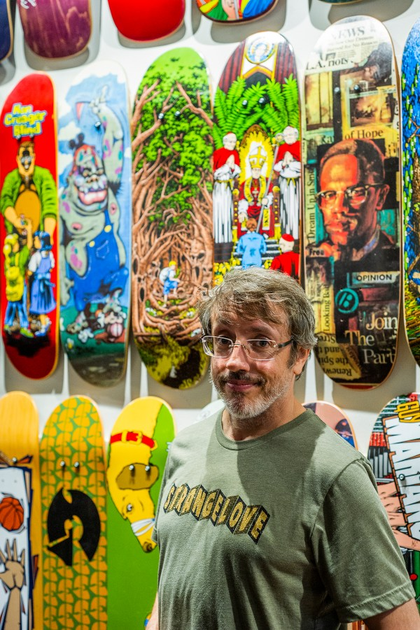 Legendary artist Sean Cliver at Deckaid with some of his masterpieces.