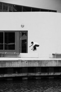 Andrew Holt backside ollies over a planter, photographed by Tom Quigley.