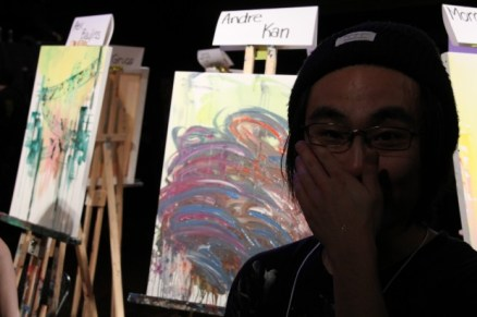 Andre Kan in front of his piece