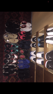 Aerial shot of shoes in two lines.