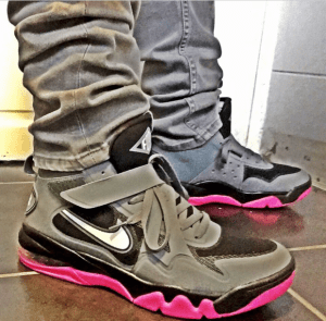 A pair of pink and grey Nike shoes.