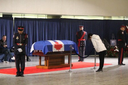 Mourner bows in honour of Rob Ford