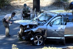 LA County Sheriff's deputies inspect Tiger Woods' vehicle.