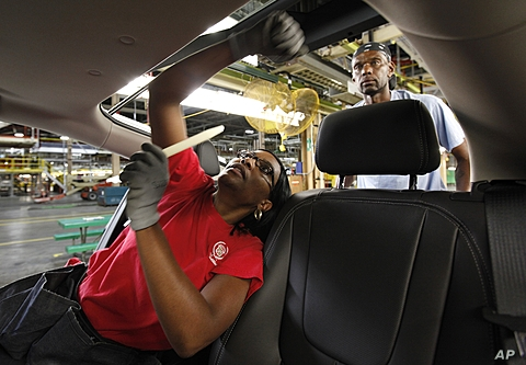 Assembly worker Julaynne Trusel works a on a 2012 Chevrolet Volt at the General Motors Hamtramck Assembly plant in Hamtramck, Michigan, July 27, 2011 (file photo).