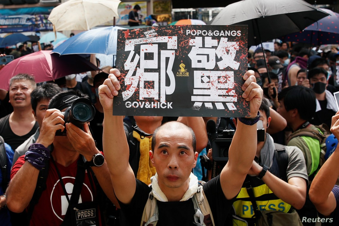 People demonstrate outside the police station during a protest against the Yuen Long attacks in Yuen Long, New Territories, Hong Kong, July 27, 2019.