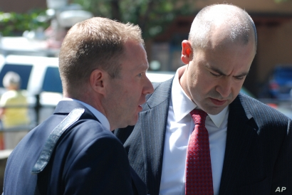 U.S. Attorney John Anderson, right and federal prosecutor Sean Sullivan converse after a former Roman Catholic priest who fled the country decades ago was sentenced to 30 years in prison on Friday, Sept. 13, 2019, in Santa Fe, N.M. Arthur Perrault,…