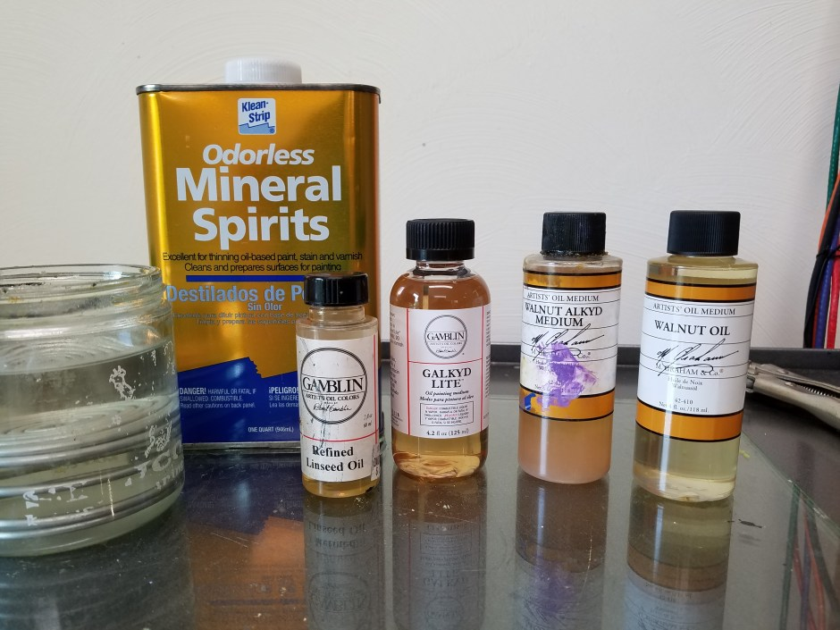 An array of painting solvents, oils, and mediums. From left to right: A glass container of clear solvent, a can of odorless mineral spirits, a small bottle of linseed oil, a bottle of galkyd light, a bottle of walnut alkyd medium, and a bottle of walnut oil.