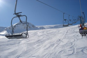 Chairlift over sunny slopes in Roccaraso