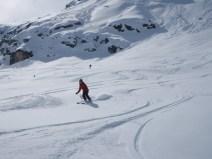 Emma just below the refuge Du Fond Des Fours after skiing the classic Vallon De Cugnai