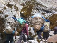Kitchen crew passing on a Mera Peak trip, Nepal