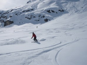 Emma just below the refuge Du Fond Des Fours after skiing the classic Vallon De Cugnai