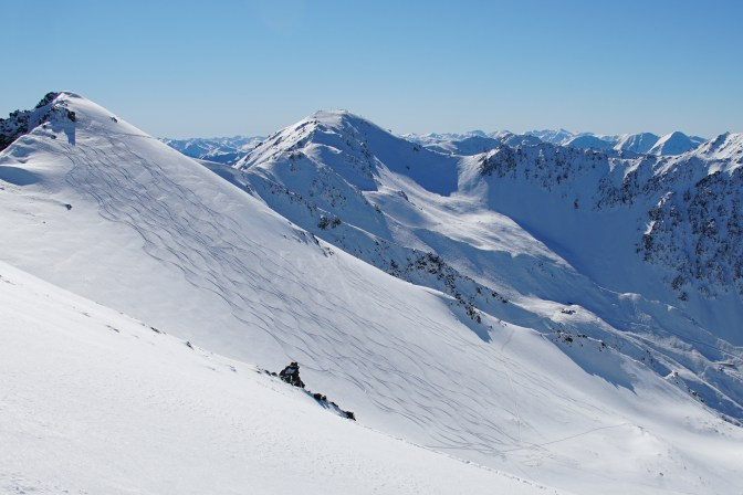 (unknown peak 1884m) with Broken River ski field & lodge in background. This was 1st Run of the day