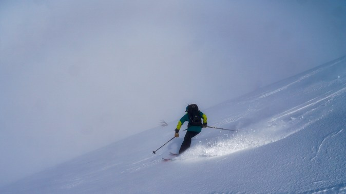 Robert skiing into the clouds