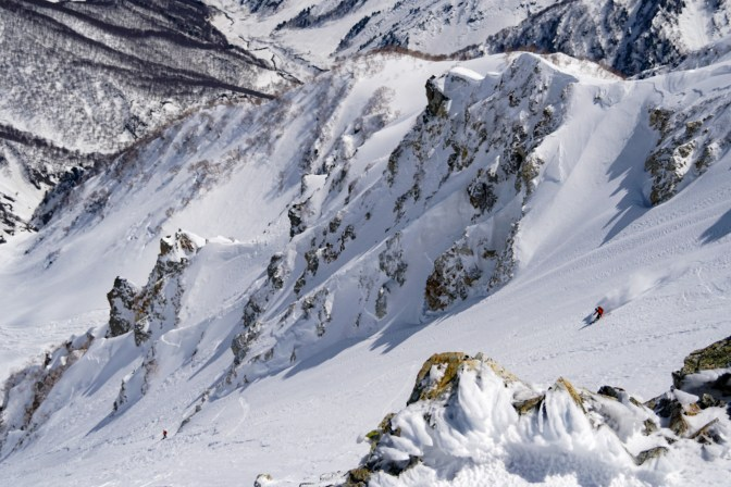 Camille skiing the East Face above the couloir