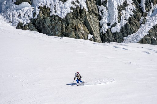 Hans skiing spring pow on the upper slope of Footstool