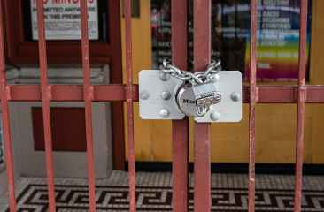 red metal gate with padlock