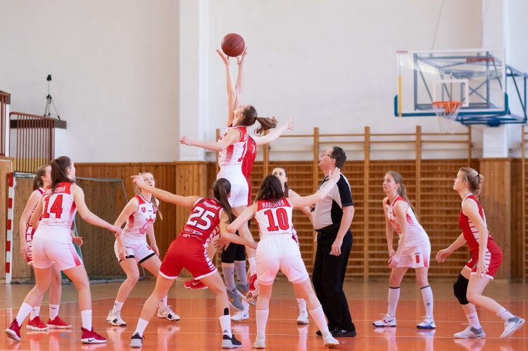 Women athletes playing basketball
