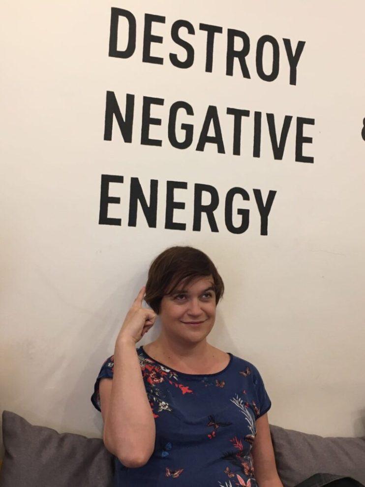 Sign saying Destroy negative energy.
