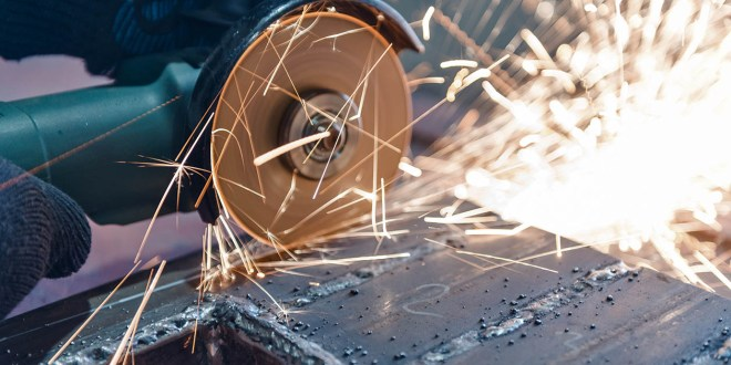 Cut metal with a Angular grinding machine. Sparks are flying. Co