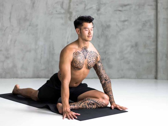 man performing the pigeon pose