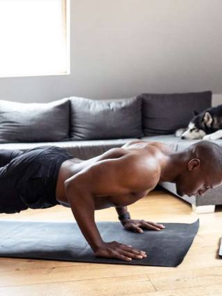 man doing yoga at home