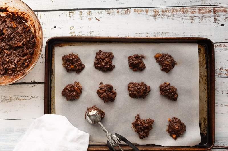 Chocolate orange marmalade cookie dough, on a baking sheet. Top down view.