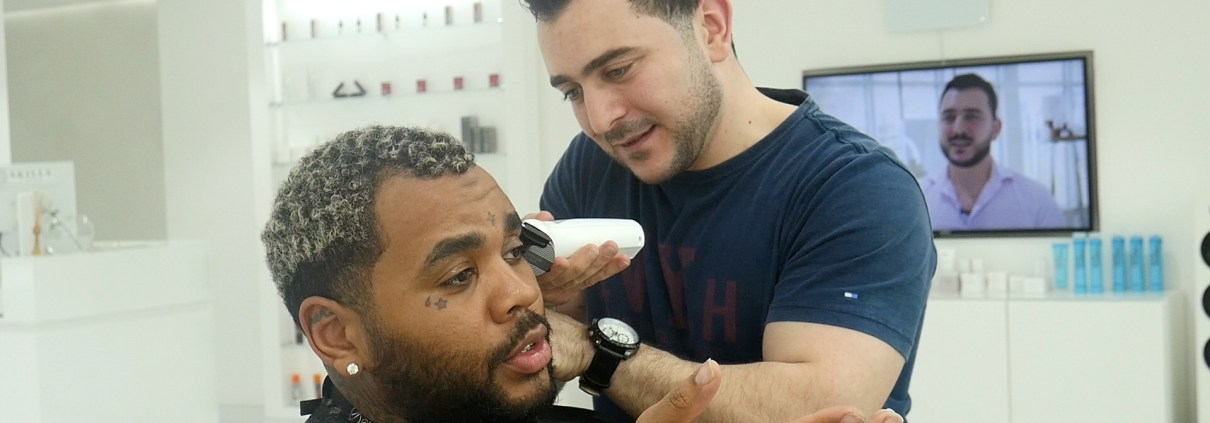 Kevin Gates being served by Celebrity Barber, Barber Mo from SKILLS Dubai Barbershop