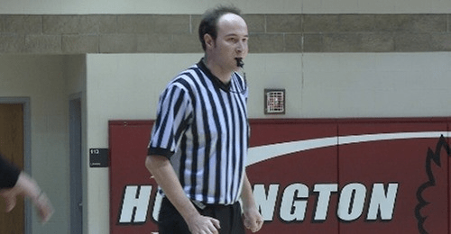 Will Fried in referee uniform blowing whistle during match