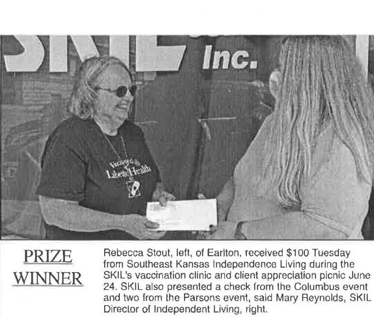 Woman on left with sunglasses on smiling while being handed an envelople. Woman on right handing an envelope with a mask on. Below is text that says Prize Winner Rebecca Stout, left, of Earlton received $100 Tuesday from Southeast Kansas Independent Living during the SKIL'S vaccination clinic and client appreciation picnic June 24. SKIL also presented a check from the Columbus event and two from the parsons event, said Mary Reynolds, SKIL Director of Independent Living, right.