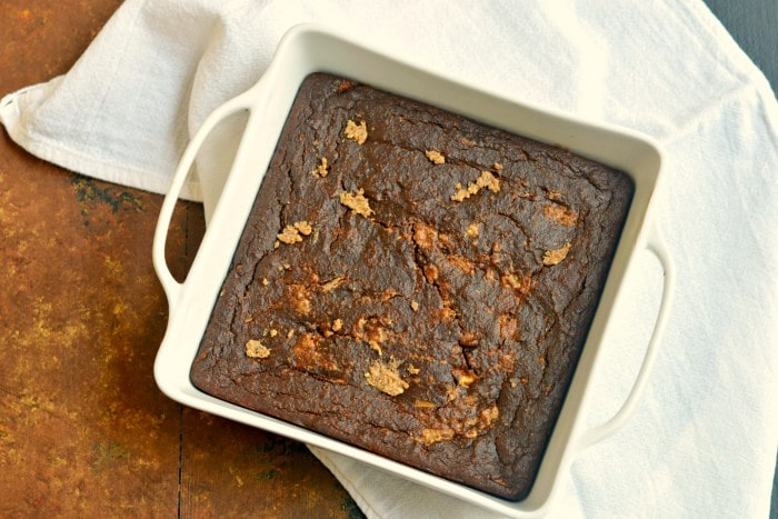 Creamy Zucchini Chocolate Espresso Brownies with an almond butter swirl! Made with almond butter, chocolate, espresso and oats, these brownies are gluten free, vegan and low calorie with a Paleo option too. Luscious chocolate-y brownies that make healthy eating easy!