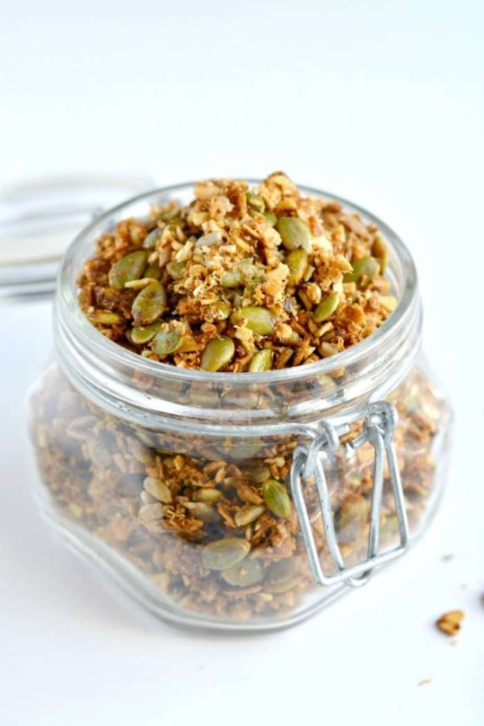 A super simple Paleo Granola made of almonds, seeds, shredded coconut and lathered in coconut oil and honey. A nutty and seedy snack that's irresistible and seriously addicting!