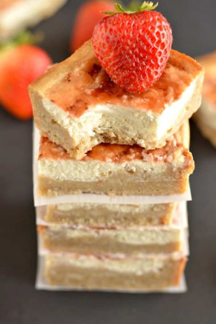 Greek Strawberry Cheesecake Bars are a light version of classic cheesecake. Made gluten free with Greek cream cheese & than the original for a healthier dessert!