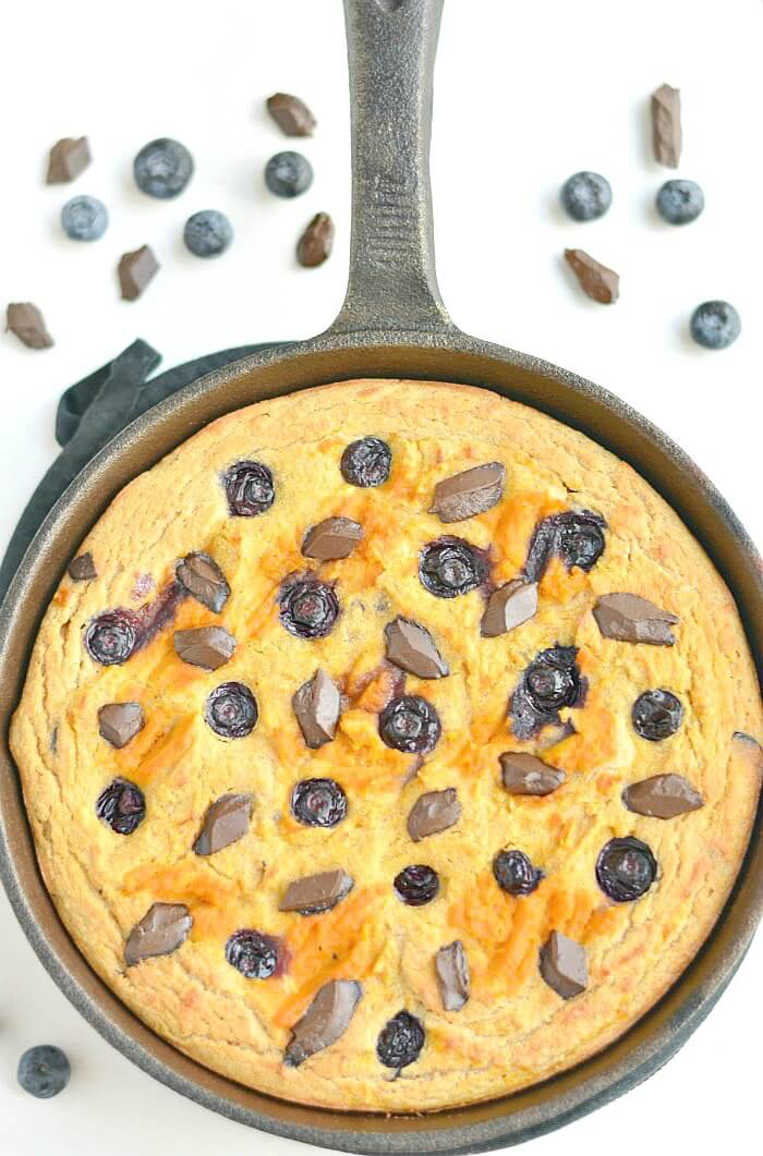 Pumpkin Blueberry Chocolate Skillet Cake! Savor the flavors of fall with swirls of pumpkin and rings of blueberries & chocolate in a thick coconut flour skillet cake that's healthy, EASY & addicting! The perfect Paleo + Gluten Free fall breakfast, dessert or snack.