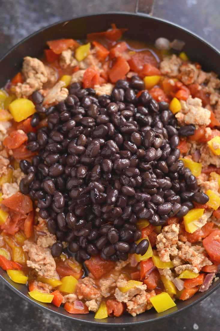 Easy & healthy Mexican Quinoa Casserole! Made with black beans, chicken & array of vegetables, this is tasty dish is one the entire family will love! Gluten Free + Low Calorie!