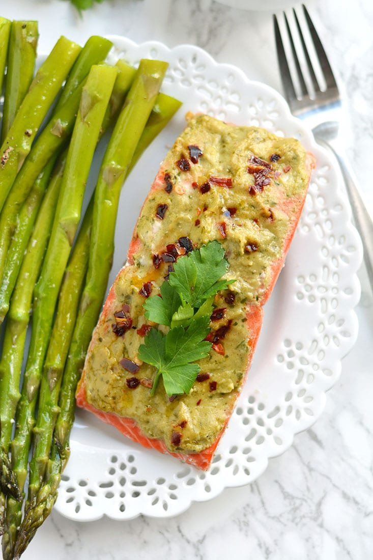 20 Minute Baked Pesto Salmon. Steamed in foil packs, this Paleo, low calorie, gluten free meal is a healthy twist on a dinner favorite! Gluten Free + Low Calorie + Paleo