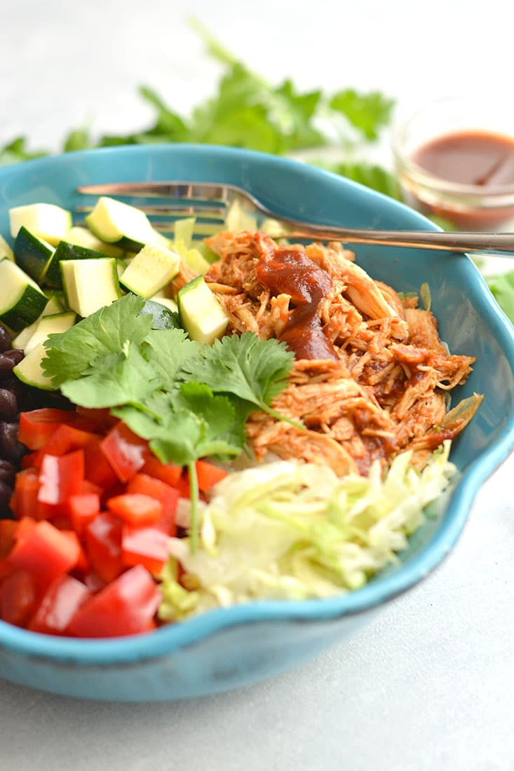 These BBQ Chicken Taco Bowls are the perfect combination of Mexican & summer BBQ flavors. A protein-packed, Gluten-Free, EASY meal prep recipe for a make ahead lunch or dinner. Gluten Free + Low Calorie