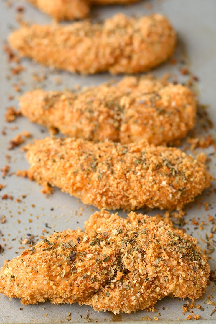 These Healthy Chicken Fingers have the same crunch of fried chicken for a fraction of the calories! Made with 4 ingredients, this Gluten Free meal is one you can feel good about eating! Gluten Free + Low Calorie