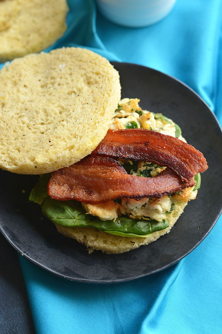 Low Carb Breakfast Sandwich made in under 2minutes in the microwave. Make them ahead of time & freeze, or make them morning, noon or night for a healthy, Paleo, low carb fluffy like a cloud bread. Paleo + Gluten Free