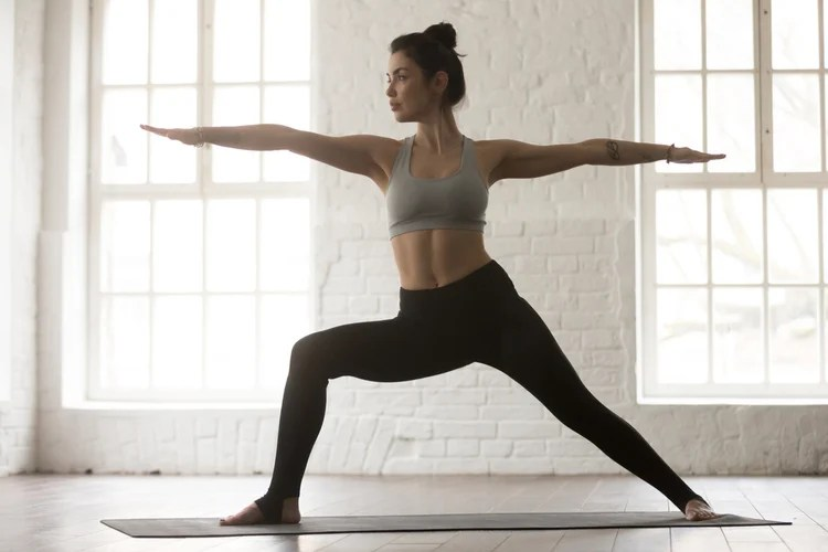 Morning yoga routine on a yoga mat, from the comfort of your home gym!