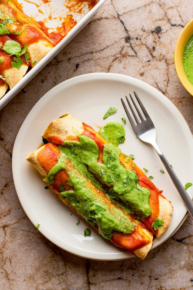 The delicious black bean and tofu enchiladas with a creamy coriander sauce make the perfect dinner or lunch break!