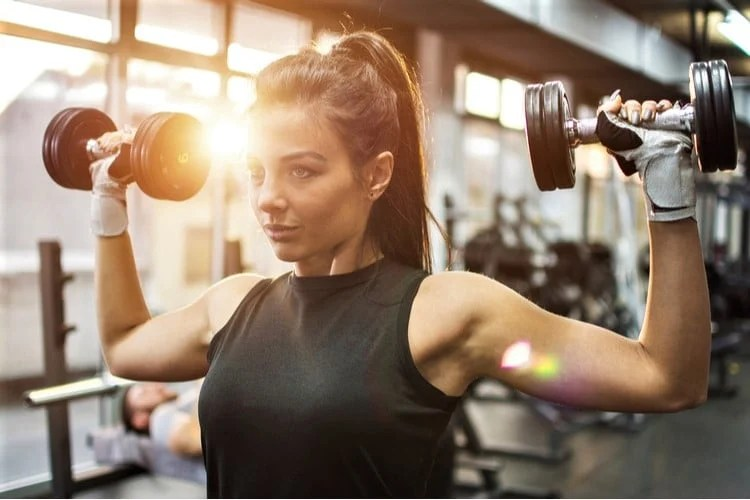 Tighten and strengthen your upper body with a dumbbell shoulder pressure.