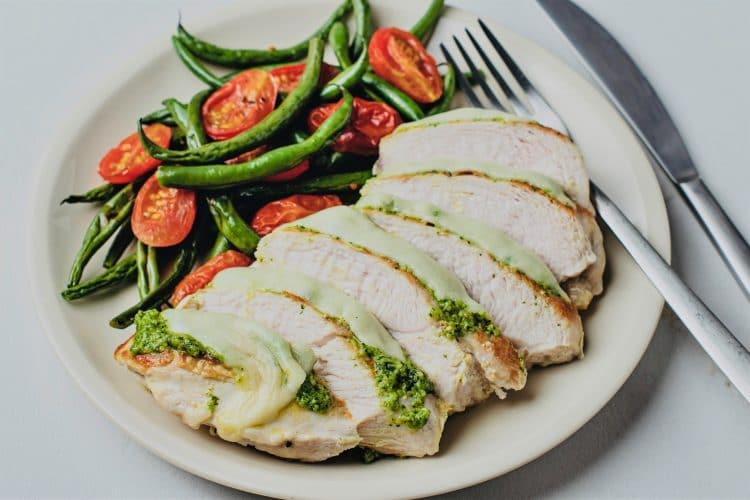 Our Roasted Tomato and Green Beans Pesto Chicken is too good not to try!